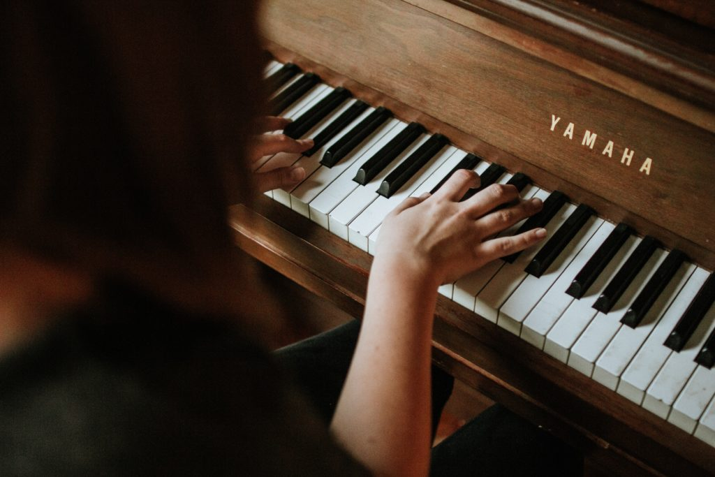 Female Playing Yamaha Piano