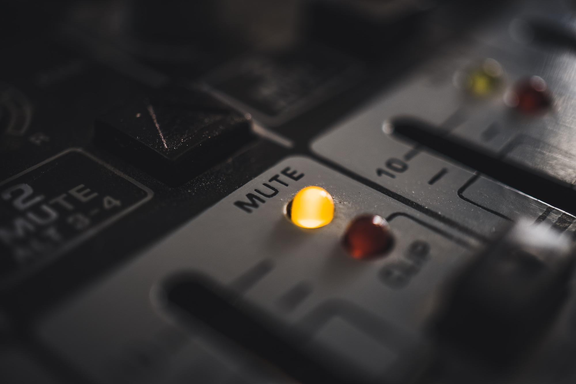 A mute LED on a modern, digital audio mixer.  by Mika Baumeister