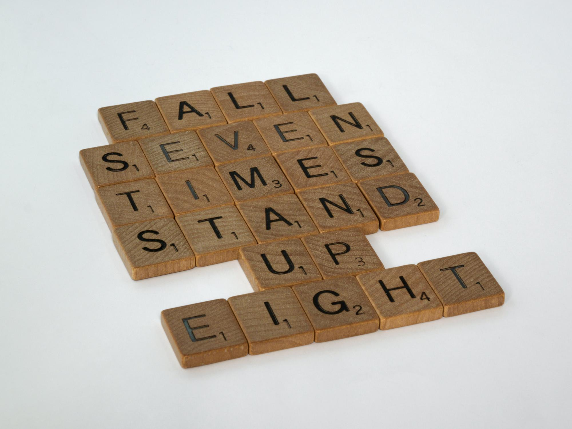 scrabble, scrabble pieces, lettering, letters, wood, scrabble tiles, words, quote, fall seven times stand up eight, don't give up, persevere, never give up, keep going, relentless,  by Brett Jordan