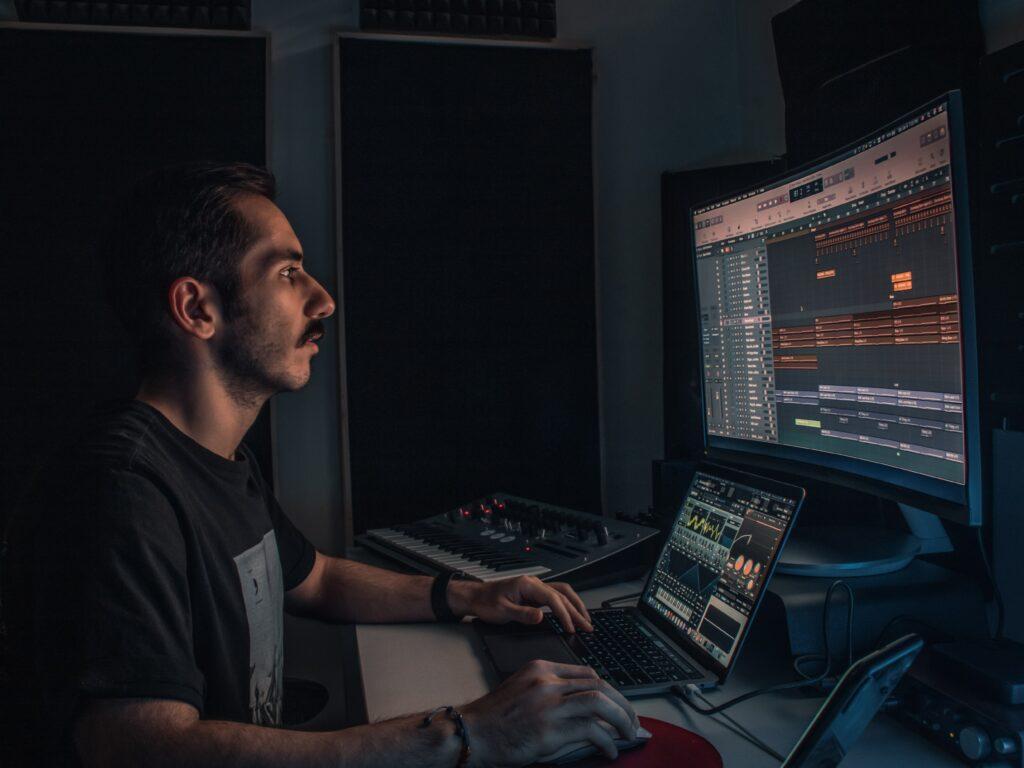Man producing on Logic Pro